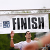 Record-Eagle/Jan-Michael Stump<br /> Runners celebrate their finish in Saturday's 29th annual Bayshore Marathon. #453