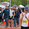 Record-Eagle/Jan-Michael Stump<br /> A runner finishes Saturday's 29th annual Bayshore Marathon with some help.#288