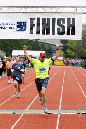 Record-Eagle/Jan-Michael Stump<br /> Runners celebrate their finish the half-marathon in Saturday's 29th annual Bayshore Marathon. #3534
