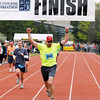 Record-Eagle/Jan-Michael Stump<br /> Runners celebrate their finish the half-marathon in Saturday's 29th annual Bayshore Marathon. #3534
