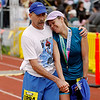 Record-Eagle/Jan-Michael Stump<br /> Runners celebrate their finish in Saturday's 29th annual Bayshore Marathon.#1894, 1893