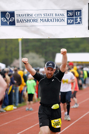 Record-Eagle/Jan-Michael Stump<br /> Runners celebrate their finish in Saturday's 29th annual Bayshore Marathon. #1081