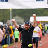 Record-Eagle/Jan-Michael Stump<br /> Runners celebrate their finish in Saturday's 29th annual Bayshore Marathon. #1081