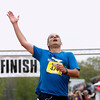Record-Eagle/Jan-Michael Stump<br /> Runners celebrate their finish in Saturday's 29th annual Bayshore Marathon. #471