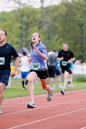 Record-Eagle/Jan-Michael Stump<br /> Runners finish the 10k race in Saturday's 29th annual Bayshore Marathon. #7651