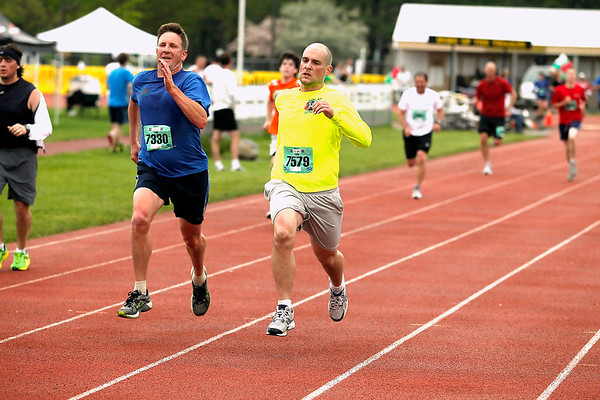 Record-Eagle/Jan-Michael Stump<br /> Runners finish the 10k race in Saturday's 29th annual Bayshore Marathon. #7330, 7579
