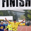 Record-Eagle/Jan-Michael Stump<br /> Runners celebrate their finish in Saturday's 29th annual Bayshore Marathon. #146