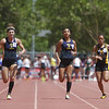 Santa Fe High School's Tiffany Garcia, left, and Akeisha Ayanniyi, right, take first and second during the girls 100 meter race at the Class AAA/AAAA State Track and Field Championships at the UNM track complex on May 17, 2014. Garcia tied the state record.  Luis Sanchez Saturno/The New Mexican