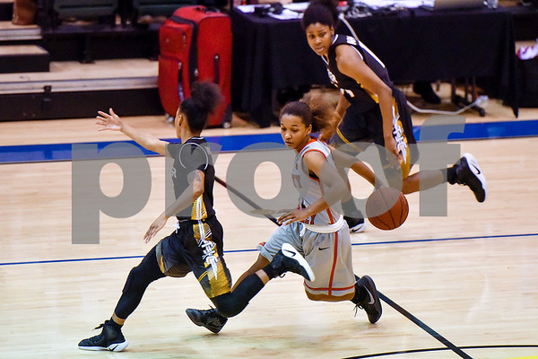 Trinity Valley College's Shakeela Fowler (11) passes the ball from behind her back during a NJCAA Region XIV basketball tournament game at John Alexander Gym in Jacksonville, Texas, on Friday, March 10, 2017. Trinity Valley College beat Tyler Junior College 72-58. (Chelsea Purgahn/Tyler Morning Telegraph)