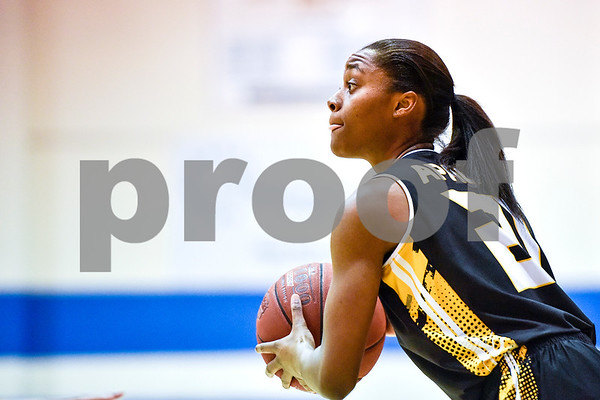 Tyler Junior College Antionette Shrepee (21) looks to pass the ball during a NJCAA Region XIV basketball tournament game at John Alexander Gym in Jacksonville, Texas, on Friday, March 10, 2017. Trinity Valley College beat Tyler Junior College 72-58. (Chelsea Purgahn/Tyler Morning Telegraph)