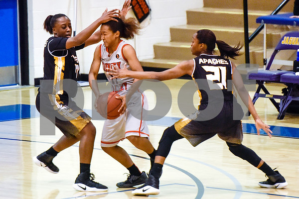 Trinity Valley College's Shakeela Fowler (11) is blocked by Tyler Junior College players during a NJCAA Region XIV basketball tournament game at John Alexander Gym in Jacksonville, Texas, on Friday, March 10, 2017. Trinity Valley College beat Tyler Junior College 72-58. (Chelsea Purgahn/Tyler Morning Telegraph)