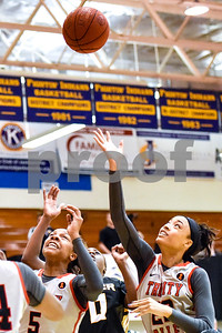 Trinity Valley College and Tyler Junior College players react to the ball during a NJCAA Region XIV basketball tournament game at John Alexander Gym in Jacksonville, Texas, on Friday, March 10, 2017. Trinity Valley College beat Tyler Junior College 72-58. (Chelsea Purgahn/Tyler Morning Telegraph)