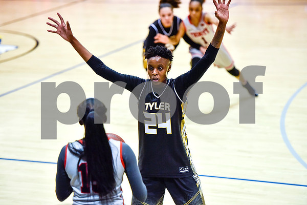 Tyler Junior College's Sky'lnn Holmes (24) guards Trinity Valley College's Malaysia McHenry (15) during a NJCAA Region XIV basketball tournament game at John Alexander Gym in Jacksonville, Texas, on Friday, March 10, 2017. Trinity Valley College beat Tyler Junior College 72-58. (Chelsea Purgahn/Tyler Morning Telegraph)