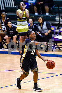 Tyler Junior College's Nautica Grant (0) points down the court during a NJCAA Region XIV basketball tournament game at John Alexander Gym in Jacksonville, Texas, on Friday, March 10, 2017. Trinity Valley College beat Tyler Junior College 72-58. (Chelsea Purgahn/Tyler Morning Telegraph)