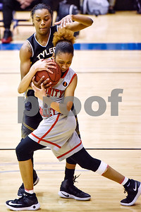 Tyler Junior College's Antoinette Shrepee (21) and Trinity Valley College's Christalah Lyons (1) struggle for control of the ball during a NJCAA Region XIV basketball tournament game at John Alexander Gym in Jacksonville, Texas, on Friday, March 10, 2017. Trinity Valley College beat Tyler Junior College 72-58. (Chelsea Purgahn/Tyler Morning Telegraph)