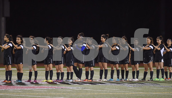 The John Tyler girls soccer team stands for the National Anthem during the District 11-6A finale at Robert E. Lee High School Friday night March 10, 2017.  (Sarah A. Miller/Tyler Morning Telegraph)