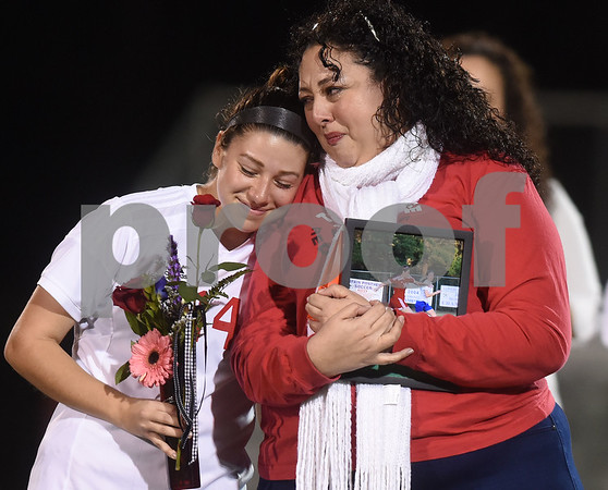 Robert E. Lee girls soccer player Brissa Renteria is met by her mom Yesenia Garcia on the field at halftime for senior night recognitions during the District 11-6A finale against John Tyler at Robert E. Lee High School Friday night March 10, 2017.  (Sarah A. Miller/Tyler Morning Telegraph)
