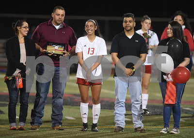 Robert E. Lee girls soccer player Jazmine Navarro is surrounded by her family on the field at halftime for senior night recognitions during the District 11-6A finale against John Tyler at Robert E. Lee High School Friday night March 10, 2017. Pictured from left: Krystal Maya, Pedro Maya, Jazmine Navarro, Raymond Navarro and Maritza Navarro.  (Sarah A. Miller/Tyler Morning Telegraph)