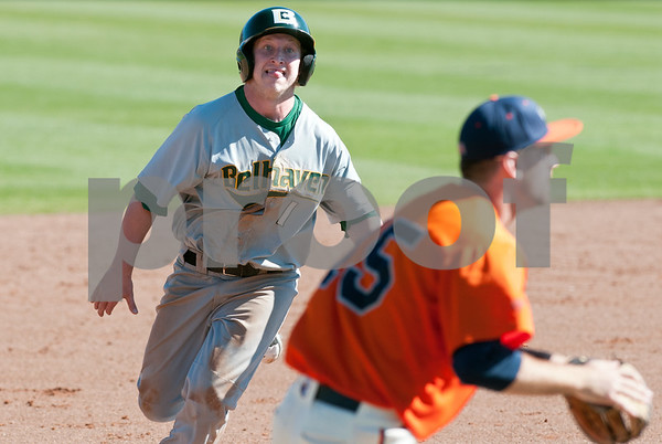 photo by Sarah A. Miller/Tyler Morning Telegraph  Belhaven University's Gabe Wilson (1) runs in to third base Tuesday during their game against University of Texas at Tyler. Also pictured is UT-Tyler's Steven Paramore (25).