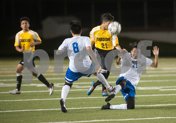 John Tyler's (21) Devan Salazar falls as he kicks the ball away during their game against Nacogdoches at Trinity Mother Frances Rose Stadium Friday night March 11, 2016.  (Sarah A. Miller/Tyler Morning Telegraph)