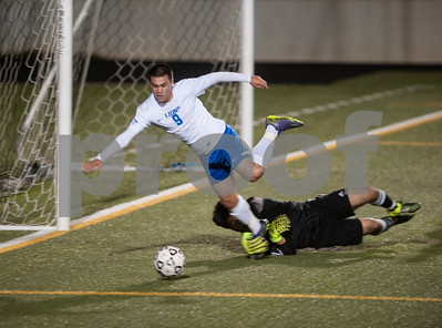John Tyler's (9) Frankie Sanchez is tripped up by Nacogdoches goalie Isaac Castellanos during the second half of their game at Trinity Mother Frances Rose Stadium Friday night March 11, 2016.  (Sarah A. Miller/Tyler Morning Telegraph)