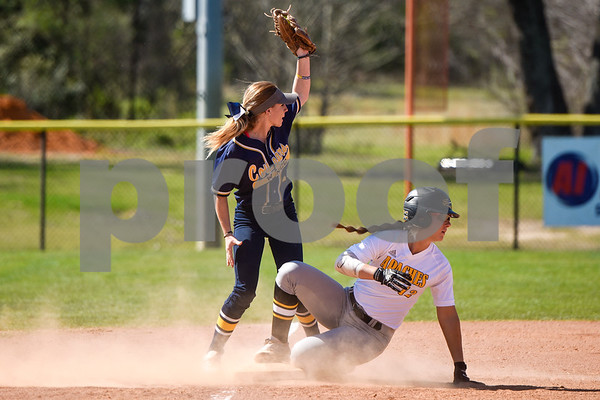 Western Nebraska Community College's Brooke Doumer (1) and Tyler Junior College's Shelbi Court (12) look up at the umpire to see if Court was tagged out but she was not during a college baseball game at The Brook Hill School in Bullard, Texas, on Monday, March 12, 2018. (Chelsea Purgahn/Tyler Morning Telegraph)