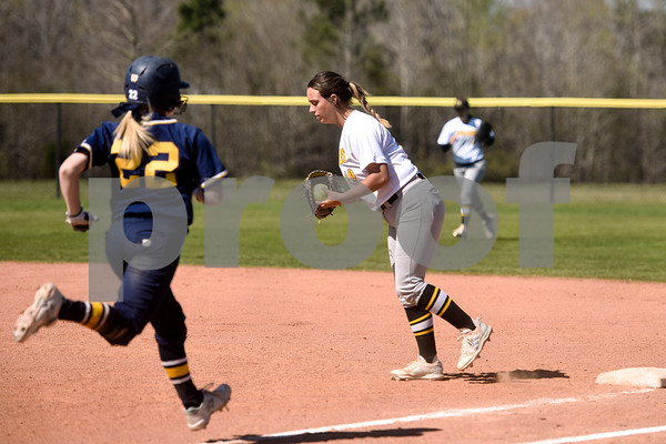 Western Nebraska Community College's Alyssa Guymon (22) runs to first base but is tagged out by Tyler Junior College's Makenzie Goswick (19) during a college baseball game at The Brook Hill School in Bullard, Texas, on Monday, March 12, 2018. (Chelsea Purgahn/Tyler Morning Telegraph)