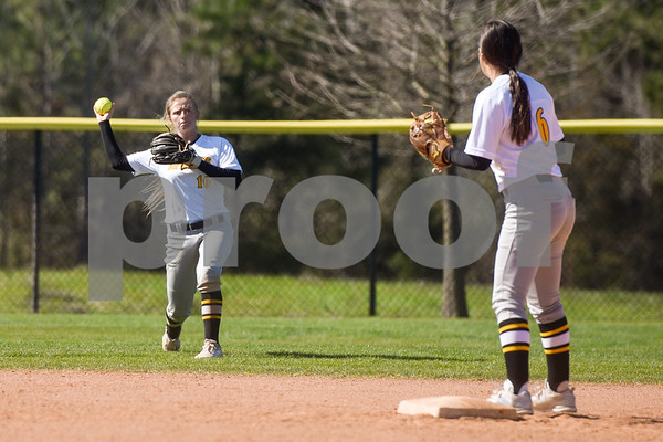 Tyler Junior College's Jaden Lance (16) throws the ball to teammate  Kaycee Parker (6) at second base during a college baseball game at The Brook Hill School in Bullard, Texas, on Monday, March 12, 2018. (Chelsea Purgahn/Tyler Morning Telegraph)