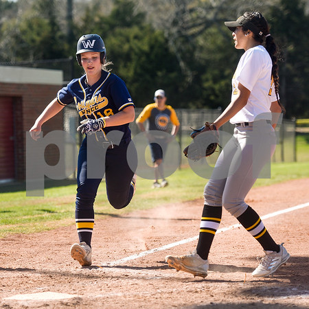 Western Nebraska Community College's Emma McMillan runs to home plate during a college baseball game at The Brook Hill School in Bullard, Texas, on Monday, March 12, 2018. (Chelsea Purgahn/Tyler Morning Telegraph)