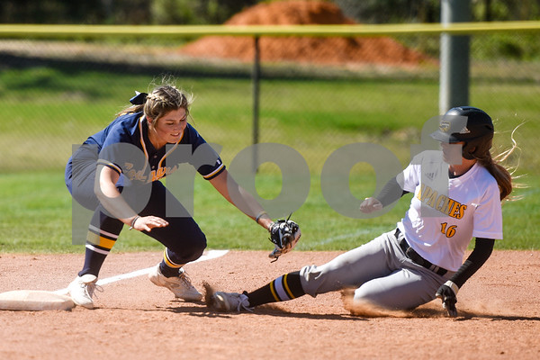 Western Nebraska Community College's Michaela Kelly (15) attempts to tag out Tyler Junior College's Jaden Lance (16) during a college baseball game at The Brook Hill School in Bullard, Texas, on Monday, March 12, 2018. (Chelsea Purgahn/Tyler Morning Telegraph)