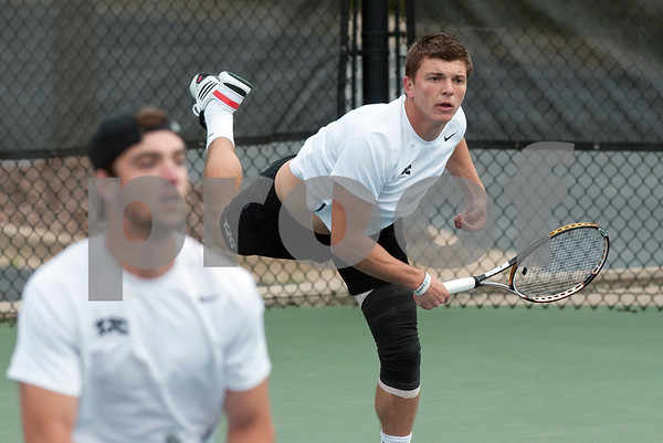 photo by Sarah A. Miller/Tyler Morning Telegraph  Tyler Junior College tennis player Mate Cutura serves the ball during his doubles match against Collin College's Graham Shaw and Christian Coetzee with teammate James Martell, left, Friday morning at the JoAnn Medlock Murphy Tennis Center in Tyler.