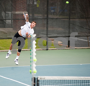 photo by Sarah A. Miller/Tyler Morning Telegraph  Tyler Junior College tennis player Mate Cutura serves the ball during his doubles match against Collin College's Graham Shaw and Christian Coetzee with teammate James Martell (not pictured) Friday morning at the JoAnn Medlock Murphy Tennis Center in Tyler.