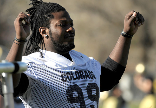 CU defensive tackle Nate Bonsu stretches during the spring football practice at the University of Colorado in Boulder, Colorado March 15, 2012.  CAMERA/MARK LEFFINGWELL