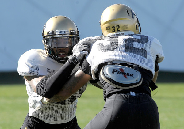 CU defensive back Sherrard Harrington (left) blocks defensive back Paul Vigo (right) during the first spring football practice at the University of Colorado in Boulder, Colorado March 15, 2012.  CAMERA/MARK LEFFINGWELL