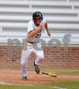 Freshman Zane Otten leaves the batters' box in search of first base. (Victor Texcucano/Staff)