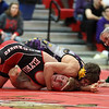 Elyria's Jordan Keegan spins out of a pin by Avon's Max Bourque of Avon during the 138-pound match. Randy Meyers -- The Morning Journal