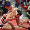 Bay's Conner McCarty forces Dylan Shawver of Elyria to the mat during the 113 pound match. Randy Meyers -- The Morning Journal