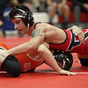 State champion Brendon Fenton of Elyria has a hold advantage over Eric Bartos of Buckeye during the 120 pound match. Fenton won the match. Randy Meyers -- The Morning Journal