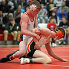 Elyria's Matt Zuckerman has a hold advantage on Mike Clark of Buckeye during the 126-pound match at the All-Star wrestling meet. Randy Meyers -- The Morning Journal