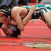 Midview's Zack Anderson and Alex Reyes of Amherst compete in the 106 pound match. Randy Meyers -- The Morning Journal