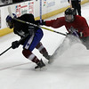 Avon's Shane Docherty (red) bodies Hayden Dickerson of CVCA away from the puck during the GCHSHL All Star Game. Randy Meyers -- The Morning Journal