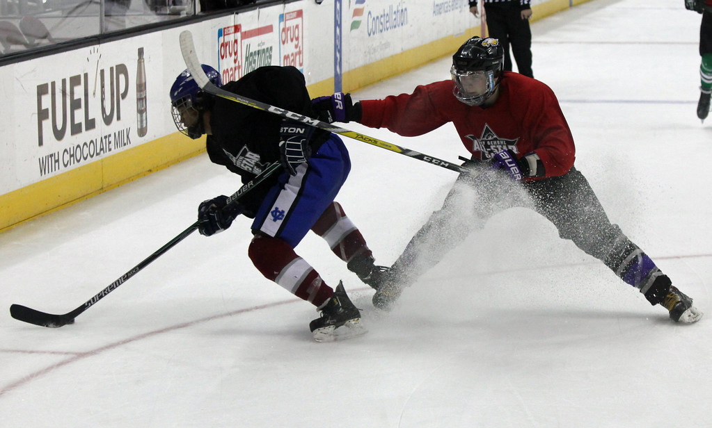 . Avon\'s Shane Docherty (red) bodies Hayden Dickerson of CVCA away from the puck during the GCHSHL All Star Game. Randy Meyers -- The Morning Journal