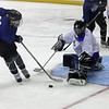 Goalie Brooks Montgomery of CVCA blocks the shot on goal by Sumner Mead of Rocky River during the GCHSHL All Star Game. Randy Meyers -- The Morning Journal