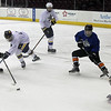 Shane Malinak of North Olmsted takes a shot on goal past Will Moyse of Olmsted Falls and towards goalie Zach Snyder from Olmsted Falls during the GCHSHL All Star Game. Randy Meyers -- The Morning Journal