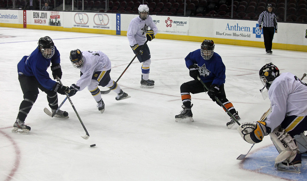 . Shane Malinak of North Olmsted takes a shot on goal past Will Moyse of Olmsted Falls and towards goalie Zach Snyder from Olmsted Falls during the GCHSHL All Star Game. Randy Meyers -- The Morning Journal