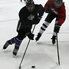 Avon's Zach Zwierecki moves the puck past Dominic Hesmondhalgh of Aurora during Friday's GCHSHL All Star Game. Randy Meyers -- The Morning Journal