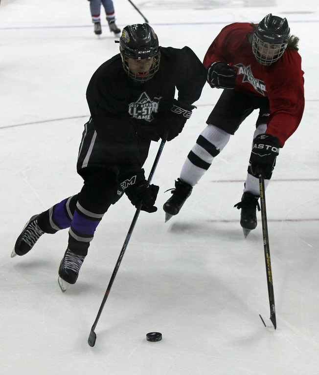 . Avon\'s Zach Zwierecki moves the puck past Dominic Hesmondhalgh of Aurora during Friday\'s GCHSHL All Star Game. Randy Meyers -- The Morning Journal