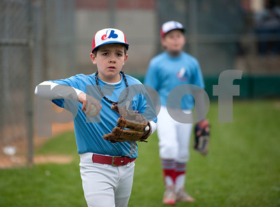 Jet Moore, 9, warms up with the Expos, a Rose Capital West Little League minors team, Saturday March 19, 2016 at Faulkner Park.  (Sarah A. Miller/Tyler Morning Telegraph