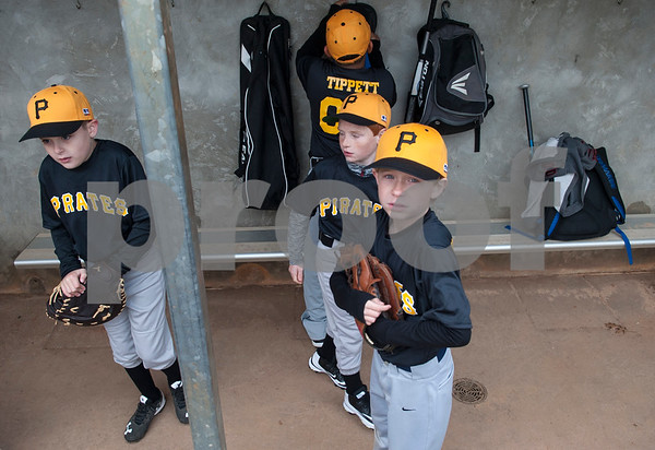 The Pirates, a Rose Capital West Little League team, get ready in their dugout for their first game Saturday March 19, 2016 at Faulkner Park.  (Sarah A. Miller/Tyler Morning Telegraph