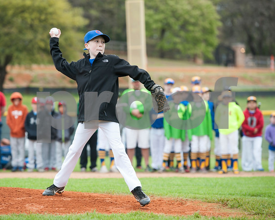 Taylor Andre, 12, gives the first pitch during the Rose Capital West Little League opening ceremony March 19, 2016 at Faulkner Park. Andre is a player on the Cubs major team. He has stage 4 neuroblastoma.  (Sarah A. Miller/Tyler Morning Telegraph